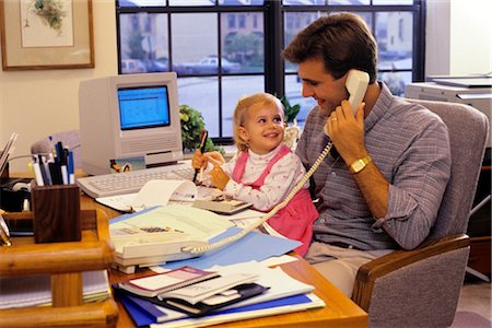 1990s FATHER WITH YOUNG DAUGHTER IN HOME OFFICE WITH APPLE MAC CLASSIC COMPUTER Stock Photo - Rights-Managed, Code: 846-02794336