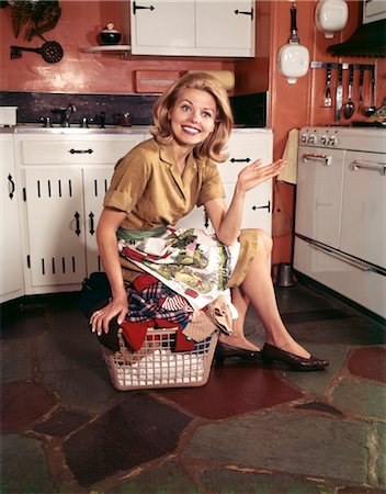 1960s YOUNG BLOND HOUSEWIFE SMILING SITTING ON TOP LAUNDRY BASKET Stock Photo - Rights-Managed, Code: 846-02794351