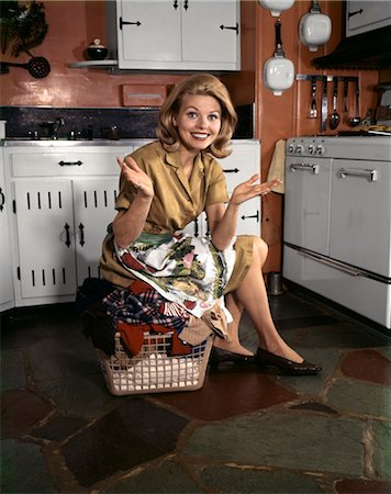 1960s YOUNG SMILING BLOND HOUSEWIFE SITTING ON TOP OF LAUNDRY BASKET KITCHEN Stock Photo - Rights-Managed, Code: 846-02794352