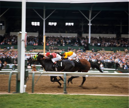 TWO RACE HORSES AND JOCKEYS NECK AND NECK GOING TO THE FINISH LINE Stock Photo - Rights-Managed, Code: 846-02794380
