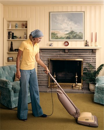 1960s WOMAN WEARING HEAD SCARF AND BELL BOTTOM PANTS CLEANING LIVING ROOM WITH UPRIGHT VACUUM CLEANER Stock Photo - Rights-Managed, Code: 846-02794403