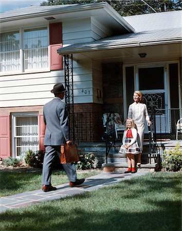 1950s MOTHER DAUGHTER WAITING STEPS HOUSE FOR FATHER BRIEFCASE COMING HOME SUBURBAN FAMILY MAN WOMAN GIRL Stock Photo - Rights-Managed, Code: 846-02794427