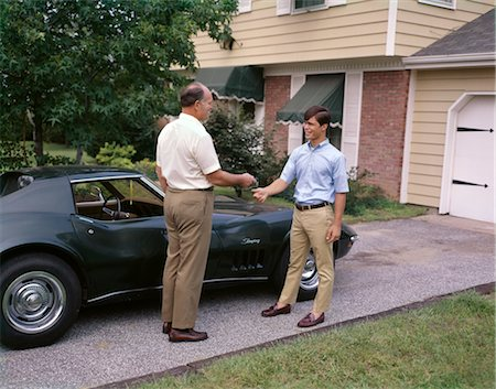 1970s FATHER HANDING TEENAGE SON KEYS TO CORVETTE CAR Stock Photo - Rights-Managed, Code: 846-02794486