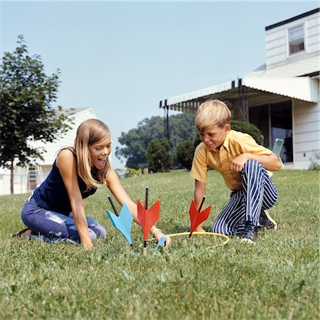 1970s BOY GIRL PLAYING LAWN DARTS GAME IN BACKYARD Stock Photo - Rights-Managed, Code: 846-02794504