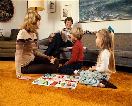 1970s FAMILY MOTHER FATHER BOY GIRL PLAYING GAME LIVING ROOM CARPET RETRO PARCHEESI FAMILIES ACTIVITY BOARD GAMES Stock Photo - Rights-Managed, Code: 846-02794595