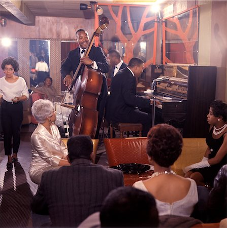 1960s AFRICAN AMERICAN JAZZ TRIO AND BLACK AUDIENCE PLAYING IN NIGHT CLUB LOUNGE Stock Photo - Rights-Managed, Code: 846-02794708