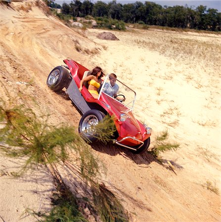 1970s MAN WOMAN COUPLE YELLOW BATHING SUIT SAND RED DUNE BUGGY BEACH Stock Photo - Rights-Managed, Code: 846-02794745