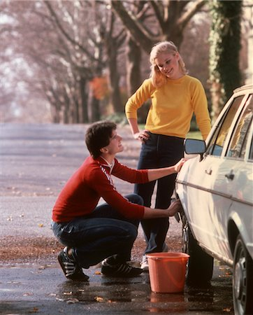 1970 1970s YOUNG COUPLE TEENS BOY GIRL MAN WOMAN WASHING CAR WASH AUTO 1980 1980s Stock Photo - Rights-Managed, Code: 846-02794837