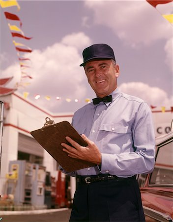 1950s 1960s MAN GAS SERVICE STATION MECHANIC HOLDING CHECK LIST ON CLIPBOARD BLUE UNIFORM HAT BLACK BOW TIE SMILING Stock Photo - Rights-Managed, Code: 846-02794838