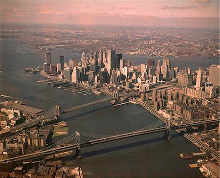 1970s AERIAL DOWNTOWN MANHATTAN LOOKING SOUTH BROOKLYN & MANHATTAN BRIDGE WORLD TRADE CENTER UNDER CONSTRUCTION Stock Photo - Rights-Managed, Code: 846-02795055