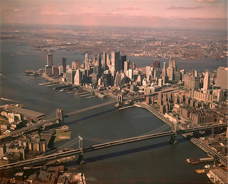 1970s AERIAL DOWNTOWN MANHATTAN LOOKING SOUTH BROOKLYN & MANHATTAN BRIDGE WORLD TRADE CENTER UNDER CONSTRUCTION Stock Photo - Rights-Managed, Code: 846-02795055
