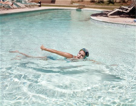 1960s WOMAN BLUE BATHING CAP SWIMMING IN WATER POOL OVERHAND STROKE Stock Photo - Rights-Managed, Code: 846-02795144