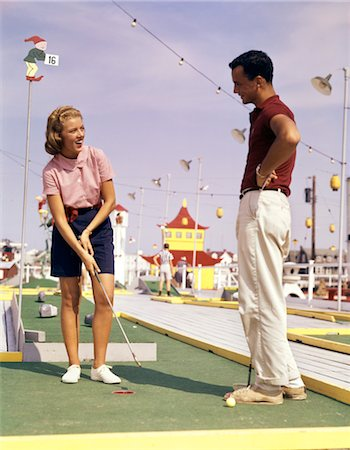1960s YOUNG COUPLE PLAYING MINIATURE GOLF Stock Photo - Rights-Managed, Code: 846-02795205
