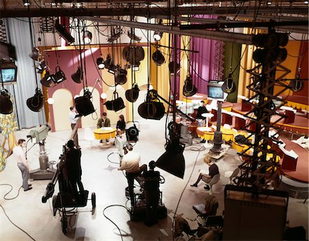 set - 1960s TELEVISION STUDIO WITH CAMERAS LIGHTS SETS ACTORS AND TECHNICIANS OVERHEAD VIEW Stock Photo - Rights-Managed, Code: 846-02795215