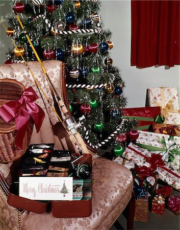 1960s CHRISTMAS TREE WITH PRESENTS FISHING POLE REEL TACKLE BOX CREEL INDOOR STUDIO COLORFUL DECORATIONS HOBBY Stock Photo - Rights-Managed, Code: 846-02795269