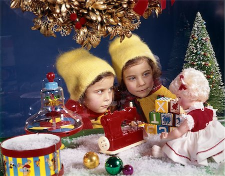 1960s TWIN SISTERS LOOKING AT TOY DISPLAY IN STORE WINDOW NOSTALGIA TWO GIRL SEASON Stock Photo - Rights-Managed, Code: 846-02795308