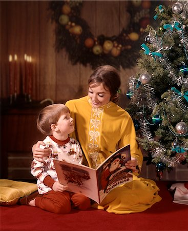 MOTHER & SON READING BY CHRISTMAS TREE Stock Photo - Rights-Managed, Code: 846-02795317