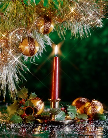 RED CHRISTMAS CANDLE STILL LIFE WITH GOLD ORNAMENTS AND HOLLY Stock Photo - Rights-Managed, Code: 846-02795334