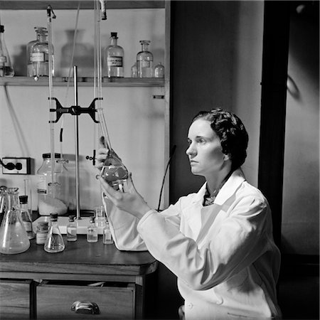 results - 1930s 1940s WOMAN SCIENTIST IN LAB COAT HOLDING UP AND EXAMINING BEAKER OF LIQUID Stock Photo - Rights-Managed, Code: 846-02795361