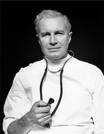 right - 1950s MEDICAL DOCTOR HOLDING TIP OF STETHOSCOPE IN RIGHT HAND Stock Photo - Rights-Managed, Code: 846-02795519