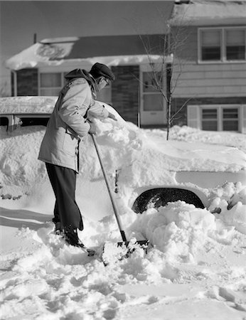 1950s MAN IN FRONT OF HOUSE SHOVELING SNOW FROM BURIED CAR Stock Photo - Rights-Managed, Code: 846-02795522