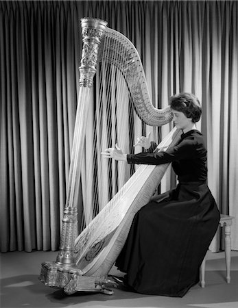 1960s WOMAN MUSICIAN IN FORMAL DRESS PERFORMING PLAYING HARP ON STAGE Stock Photo - Rights-Managed, Code: 846-02795601