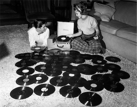 1950s TEENAGE COUPLE PLAYING MANY MUSIC RECORDS SPREAD OUT ON LIVING ROOM FLOOR Stock Photo - Rights-Managed, Code: 846-02795623