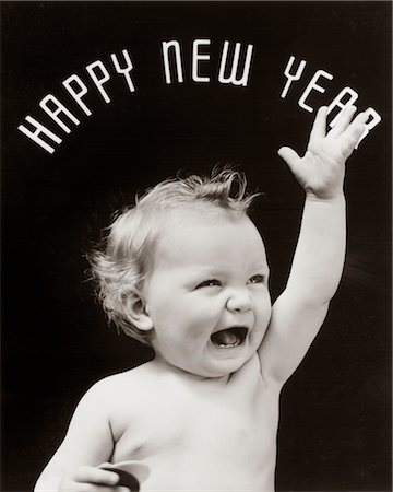 1930s BABY WITH MOUTH OPEN AND HAND RAISED WITH HAPPY NEW YEAR SPELLED OUT IN ARC OVER HEAD Stock Photo - Rights-Managed, Code: 846-02795720