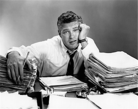 1950s PORTRAIT MAN OVERWORKED WITH DESK FULL OF PAPERS Stock Photo - Rights-Managed, Code: 846-02795767