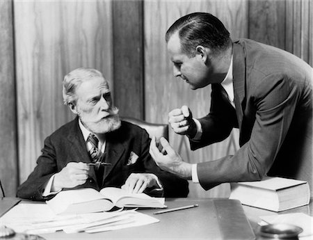 1930 1930s TWO MEN IN OFFICE AT DESK TALKING Stock Photo - Rights-Managed, Code: 846-02795779