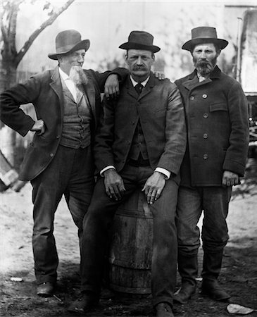 1890s TURN OF THE CENTURY GROUP OF THREE MEN WITH BEARD OR MUSTACHE WEARING HATS ONE SITTING ON BARREL Stock Photo - Rights-Managed, Code: 846-02795915