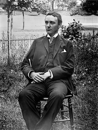 1890s 1900s TURN OF THE CENTURY PORTRAIT OF MAN IN THREE-PIECE SUIT SEATED IN CHAIR OUTSIDE Stock Photo - Rights-Managed, Code: 846-02795912