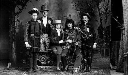 1890s TURN OF THE CENTURY PORTRAIT GROUP OF FIVE MEN ACTORS IN VARIOUS COSTUMES AGAINST PAINTED STUDIO BACKDROP Stock Photo - Rights-Managed, Code: 846-02795974