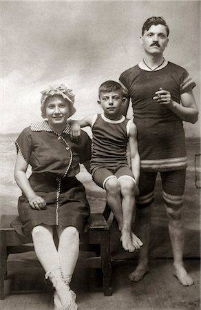 1890s 1900s FAMILY PHOTO PORTRAIT MOTHER FATHER CHILD BOY SON WEARING ANTIQUE BATHING SUITS IN SEASHORE STUDIO Stock Photo - Rights-Managed, Code: 846-02796019