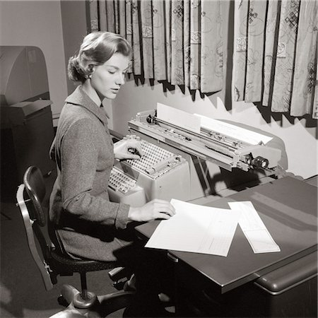 secretary desk - 1950s SECRETARY SITTING AT DESK READING FROM LEDGER MAKING ENTRIES ON COMPTOMETER Stock Photo - Rights-Managed, Code: 846-02796024