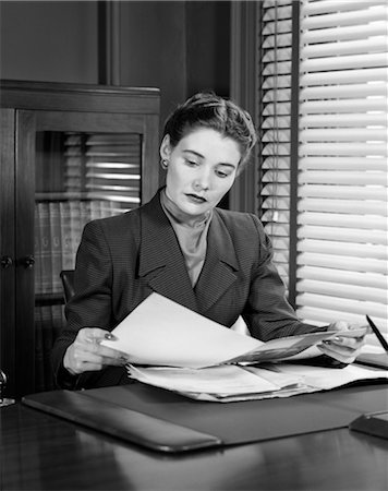 secretary desk - 1950s WOMAN BUSINESS DESK READING PAPERWORK PEN BOOKCASE Stock Photo - Rights-Managed, Code: 846-02796055