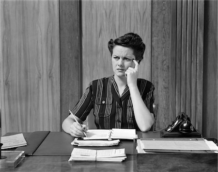 secretary desk - 1940s WORRIED WOMAN BUSINESSWOMAN EXECUTIVE AT DESK THINKING Stock Photo - Rights-Managed, Code: 846-02796078