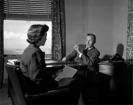 secretary desk - 1950s MAN WOMAN SECRETARY BOSS TELEPHONE DESK PAPERWORK Stock Photo - Rights-Managed, Code: 846-02796097