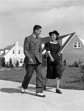 1940s TEENAGE COUPLE WALKING ON SUBURBAN SIDEWALK Stock Photo - Rights-Managed, Code: 846-02796212