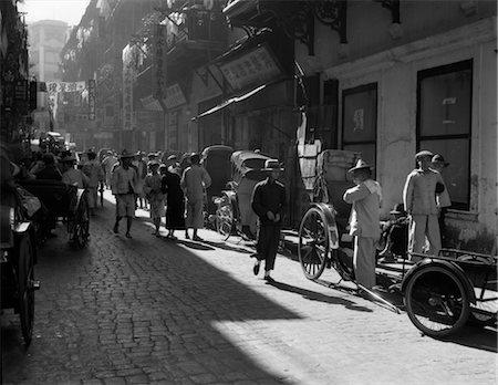 1920s 1930s STREET SCENE RICKSHAWS WAITING FOR HIRE HONG KONG CHINA Stock Photo - Rights-Managed, Code: 846-02796278