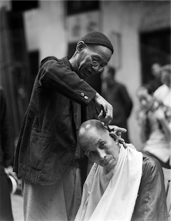 1920s 1930s CHINESE MAN SIDEWALK BARBER IN SKULL SHAVING ANOTHER MAN'S HEAD HONG KONG CHINA Stock Photo - Rights-Managed, Code: 846-02796280