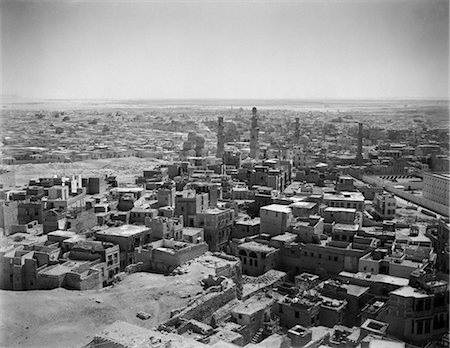 1920s 1930s ELEVATED OVERVIEW OF CAIRO EGYPT FROM THE CITADEL SKYLINE DOTTED WITH MINARETS CITYSCAPE Stock Photo - Rights-Managed, Code: 846-02796314