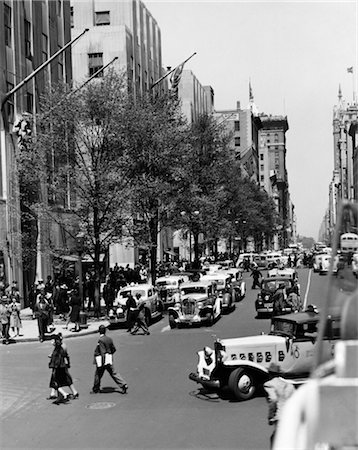 1939 1930s RETRO ROCKEFELLER CENTER AUTOMOBILE AND PEDESTRIAN TRAFFIC FIFTH AVENUE NEW YORK CITY USA Stock Photo - Rights-Managed, Code: 846-02796328