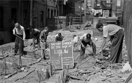 1940s BOYS WORKING IN WARTIME VICTORY GARDEN LUDLOW STREET NEW YORK CITY LOWER EAST SIDE MANHATTAN WWII Stock Photo - Rights-Managed, Code: 846-02796354