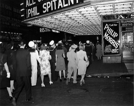 1940s NYC BROADWAY AT NIGHT MARQUEE OF MOVIE THEATER WITH SOLDIERS SAILORS AND WOMEN ON THE SIDEWALK OF WEST 51st STREET NEW YORK CITY USA Stock Photo - Rights-Managed, Code: 846-02796355