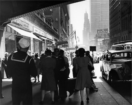 1940s GRAND CENTRAL STATION PEDESTRIAN SAILOR UNIFORM TAXI STORE MEN WOMEN 42ND STREET SIDEWALK NYC USA Stock Photo - Rights-Managed, Code: 846-02796364