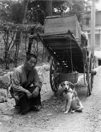 1930s JAPANESE MAN VEGETABLE VENDOR FARMER WITH CART SIDE OF ROAD KNEELING SMILING WITH PER DOG JAPAN Stock Photo - Rights-Managed, Code: 846-02796360