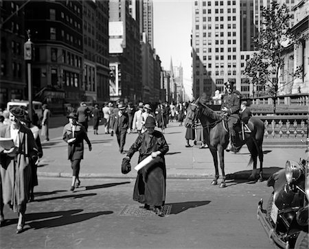 1930s MOUNTED POLICEMAN FIFTH AVENUE 40TH STREET WATCHES AS OLD WOMAN CROSSES THE STREET NEW YORK CITY USA Stock Photo - Rights-Managed, Code: 846-02796361