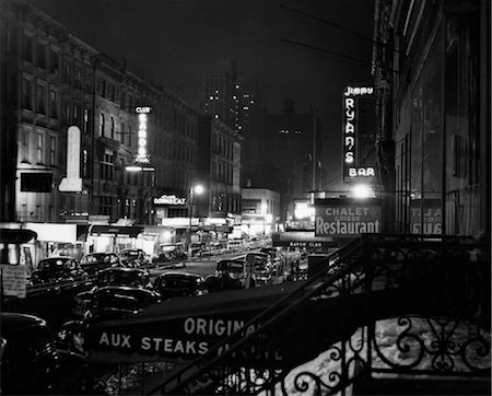1930s 1940s NIGHT STREET SCENE NEW YORK CITY WEST 52nd STREET LIGHTS FROM NUMEROUS CLUBS AND NIGHTCLUBS Stock Photo - Rights-Managed, Code: 846-02796378