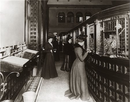 right - 1890s 1900s TURN OF CENTURY BANK INTERIOR WOMEN BANKING SPECIAL TELLERS Stock Photo - Rights-Managed, Code: 846-02796464